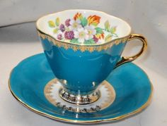 ROYAL WINDSOR ENGLAND GOLD BRAMBLE BERRY BLUE TEA CUP AND SAUCER