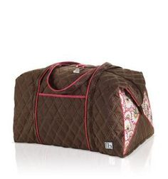 """BELLA FIORE COCOA VACTATIONER Whether your itinerary is packed with activities or you're just a hopeless overpacker (can you ever have too much room?), this super-sized duffel is your new best friend. Generous enough to hold everything you'll need for a week away, it's big and sturdy but amazingly lightweight. 24""""W x 14""""D x 14""""H  16"""" strap drop"""