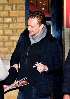 Tom Hiddlestonleaves the Donmar Warehouse after performing his playCoriolanusto sign autographs for his fans on Thursday evening (December 12) in London, England.