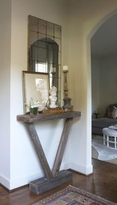 perfect narrow shelf for entry way....i love the mirror with it, too...maybe some hooks to add function