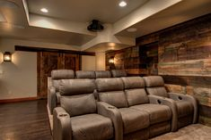 This basement remodel is industrial, modern, and chich for a unique finish cutomized for these homeowners. Including a home theater, bathroom and wet bar! Get your custom-designed basement remodel started with FBC Remodel today. Home Theater Rooms, Home Theater Design, Home Theater Seating, Industrial Basement, Modern Industrial, Basement Inspiration, Home Entertainment, Basement Remodeling, Great Rooms