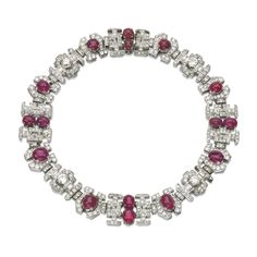 Ruby and diamond necklace, 1930s Of geometric design, set with cabochon rubies, circular-, single-cut and baguette diamonds, length approximately 450mm, French assay and maker's marks, several diamonds deficient.