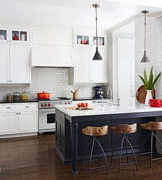THIS IS THE INSPIRATION KITCHEN FOR THE REMODEL.  love the white cabinets, white subway tile, blue island, with warm natural wood tones.