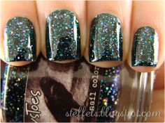 "lacquerisawesome:  CrowsToes ""Triple Black Diamond"" over A England ""St. George"" — black, blue, purple and aqua glitters give this polish combo a deep, dark sparkle  (via steffels.: CrowsToes Triple Black Diamond)  Looks like granite countertops - Cool!"
