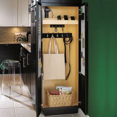 Hang up keys, bags, and pet leashes in the shallow Drop Zone cabinet—it even has a built-in charging station for handheld gizmos. It comes 9 or 24 inches deep, 84 or 96 inches high, and can cap a run of cabinets. From $500; diamondcabinets.com for dealers