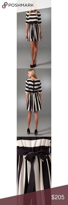 """Alice + Olivia Striped Emmie Dress Silk This wide-neck striped silk dress features a detachable self-belt tie and gathered elastic banding at the waist. 5-snap closure at back. Elbow-length sleeves. Lined. - 33"""" long, measured from shoulder. - fabrication: stretch silk - shell 95% silk, 5% spandex - size medium, excellent preloved condition with no stains - retailed for $367 & is sold out - !!NO TRADES!! Alice + Olivia Dresses"""