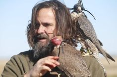 A falconer and his bird.