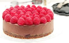 This decadent chocolate cake sits atop a crust of dates and raw cashews and hazelnuts. The chocolate filling is smooth and creamy, while raspberries add a fruity note that prevent it from being overly rich.