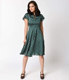 Welcome to the Formosa, darlings. The Formosa dress is a pine-worthy 1940s inspired swing in a elegant emerald green and ivory polka dot fabrication, fabulously fresh from Unique Vintage! A feminine poly satin frock boasting a self tie keyhole neckline me