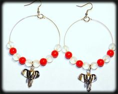 red and frosted white beaded hoops with an elephant charm
