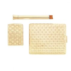 Cigarette Case and Cigarette Lighter, Tiffany & Co. and Gold and Metal Cigarette Holder, Cartier for Sale at Auction on Tue, 09/13/2011 - 07:00 - The Estate of Douglas Fairbanks, Jr. | Doyle Auction House