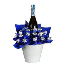 This beautiful chocolate bouquet features a bottle of Moa Beer amidst a bed Lindor and Belgian chocolates. Includes: 750ml bottle of Moa Beer, 10 Dark Chocolate Lindt Balls, 15 solid Belgian milk chocolate stars from Chocolatier, Gold Keepsake Tin Bucket, Complimentary gift wrapping and gft card.