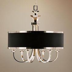 This sleek chandelier has silver plated metal matched with one dramatic black hardback shade.