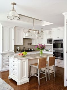 Designer Elissa Cullman used brushed-nickel accents and modern appliances to elevate the kitchen of a 1920s New York penthouse