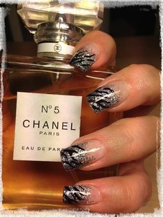Gel nails with silver glitter tips and black stripes
