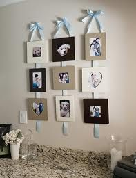 hanging picture with ribbon inatead of 3 pictures use one and keep the long ribbion to store baby bows