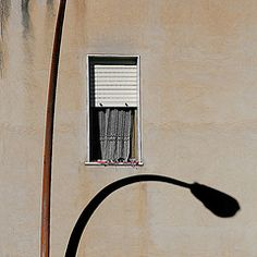 Identit autonoma (salvatore tardino) Tags: windows shadow muro wall canon casa ombra ombre finestra taglio sicily 5d curve parete palo sicilia tenda lampione composizione tapparella linee facciata ocra prospetto canicatt