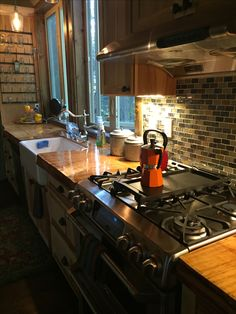 Treated red fir counter top, farmhouse kitchen sink for cabin rebuild