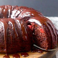 - Chocolate Cherry Fudge Bundt Cake Chocolate cherry fudge goodness doesn't get much easier than this. A stunning chocolate bundt cake with plenty of cherries and a fudge glaze is just what the doctor ordered! Cherry Desserts, Just Desserts, Delicious Desserts, Cake Mix Recipes, Dessert Recipes, Food Cakes, Cupcake Cakes, Chocolate Cherry Cake, Chocolate Bundt Cake Glaze