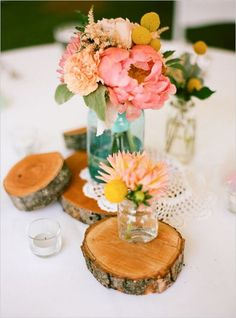 spring wedding centerpiece with tree stumps / http://www.himisspuff.com/rustic-wedding-ideas-with-tree-stump/9/