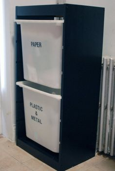Great use of the cheap Ikea Trofast system for recycling!! Looks better than ugly plastic garbage cans in the kitchen.