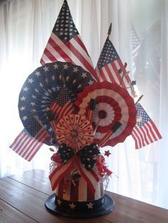 4th of July Centerpiece Made Out Of A Recycled Coffee Can And Paper Rosettes @11magnolialane