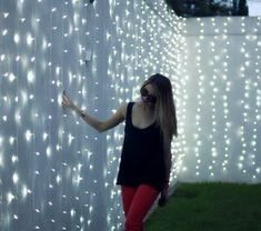 Strings of white lights on a white fence. Just beautiful!