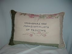 "Grandmas are sweet. This hand-embroidered message on canvas conveys that truth. This pillows measures 12"" x 16"" and is trimmed with calico strips and piping."