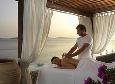 Relax while having a massage by the Aegean sea at the Mykonos Grand 5 Star Luxury Resort & Hotel.