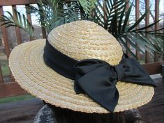 This is a new condition sun hat . Made of 100 % straw in Great Britain . It has and elastic strap the you can use to keep it in place or simply tuck it in the hat if you dont need it . Perfect for weddings , vacation , cruises . beach or pool . I have seen similar hats by Laura Ashley sell for upwards of $ 100.00 . You wont find a nicer one . The tag is still intact inside and it is nice and clean . Please feel free to ask any questions before you purchase . Vintage clothing and accessories…