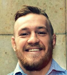 smiling portrait of proud Irish fighter: Conor McGregor : Shop at CageCult for powerful #MMA fashion for #MixedMartialArts fighters and fight fans: http://cagecult.com/mma