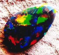 gem black opal fire   top quality -several pieces found in one rock matching