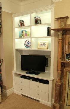 Victorian alcove bookcase with built in LED lights and drawers