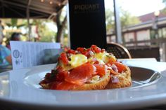 """Brunch? Presenting our """"Smoked Salmon Benedict"""". Two poached eggs and smoked salmon on hand-crafted lemon thyme scones drizzled with hollandaise. Topped with a gremolata of fresh tomato, red onion, capers, lemon zest and dill."""
