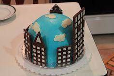 superhero cake - buildings made of chocolate bars, windows royal icing