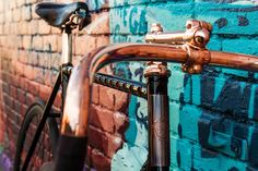 Beautiful custom made bicycle against a graffiti wall. Photos   Detroit Bicycle Company