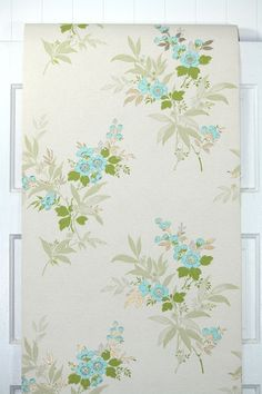 This roll of wallpaper is an authentic, old stock roll from the 1960s. It is priced by the double roll. One double roll will cover approximately 50 sq. ft.