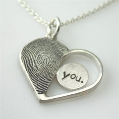 Necklace with his and hers thumbprints engraved onto each half of the heart.  How unique!