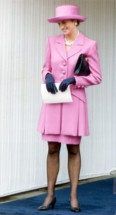 The Princess of Wales chose a pink box-pleat coat and navy gloves with a wide-brimmed fuchsia Breton hat for an Order of the Garter ceremony at Windsor Castle in 1993.