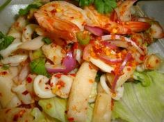 Seafood Salad :Quick boiled assorted seafood seasoned with lemon grass, onion, mint leaves and chili (served on top of lettuce) from Nine & Nine Thai Restaurant Colorado #Food #Salad #Restaurant forked.com