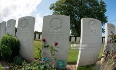 A photo of private Robert Boulanger lies in front of his tombstone at the Canadian War Cemetery near Dieppe, France, 18 August 2013, on the eve of the 71st anniversary of the Dieppe raid. More than 6000 allied troops, mostly Canadians, landed on 19 August 1942. At the end of the day, after a fierce battle, the Allies had 1550 dead and some 2400 prisoners. Dieppe's citizens and guests read the names of the 948 Commonwealth servicemen of WWII who are buried or commemorated in this cemetery.