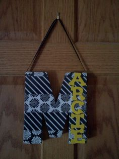 Door hanging for kids room. Cardboard letter, mod podged with scrapbook paper for the M and small painted wood letters