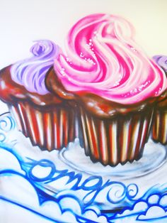 The iconic cupcake graffiti wall art in OMG Baked Goodness on Dundas West in Toronto.