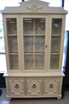 """Freshly Painted Distressed Look China Cabinet with Wall Papered Back! Lovely Blue White Toile Pattern - It lights up! Has 2 glass shelves and 3 bottom cupboards - 49.5""""W x 16""""D x 82.5""""High - very very pretty and extremely practical!"""