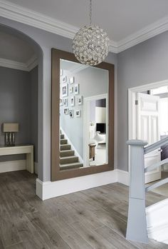 Mirror bottom of stairs? This is contemporary design at its finest, transforming a traditional space into modern living, creating an ambiance of welcome and warmth. Garderobe Modern Design, Flur Design, Living Room Orange, Hallway Inspiration, Hallway Designs, Hallway Decorating, Luxury Home Decor, Grey Home Decor, Design Case