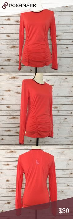 "LOLE Long Sleeve Wicking Athletic Shirt Women's LOLE long sleeve wicking athletic ruched top with thumbholes and velvet trim around the neck and sleeves. It's a deep coral color in great preowned condition. The material is 100% wool. Bust size laying flat: 16.75"", Length: 23.75"". Feel free to message me with any questions.  Lole Tops Tees - Long Sleeve"