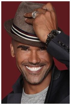 Shemar Moore.  The hat is a great added touch. Fellas, never underestimate the power of a beautiful smile-its a great icebreaker...