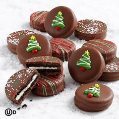 Everybody goes Ho-Ho-Ho for chocolate-covered OREO® Cookies… the perfect gift that special person on your holiday list. Created exclusively for us, these delicious cookies are decorated with green, red and white snowflakes, Christmas trees, and topped with matching swizzles to make their Christmas extra fun and festive.