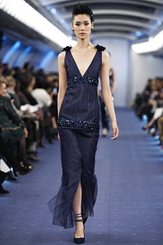 I love that the Chanel Spring Couture Line for 2012 has a ton of navy blue!! (my favorite color). I wish I had something to go to so then I could design my own dress similar to this!