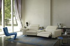 Prianera   Sorrentino   The peculiar shape of the sofa Sorrentino contains technological heart: you can modify the seatings with a simple gesture, and they become comfortable chaise-longue. Touching the buttons, you can control both headrest and footrest positioning them in multiple configurations.